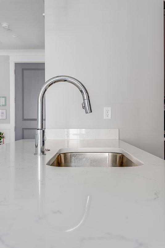 Modern kitchen sink with white marble countertop
